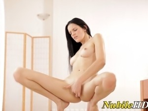 Teen fingers herself in pussy