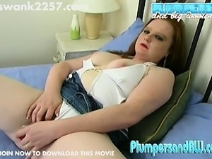 Chubby redhead Crimson lets her tight pussy have it in this