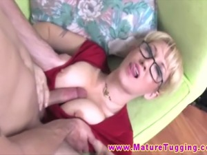 Big titted granny giving handjob to a younger dude