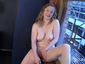 Sexy amateur blonde Lili masturbating her delicious muff at the window