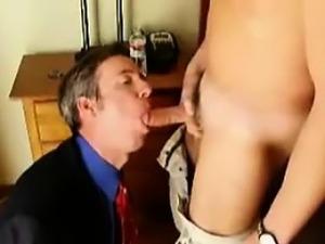 fully clothed businessman sucks toyboy