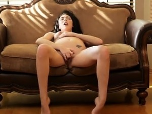 Buxom brunette Hanna Lay fondles her tits and pinches her