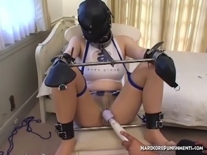 Chained and shackled hooded Asian cheerleader wand orgasms