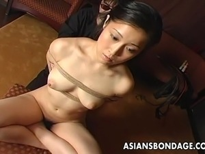 Naughty Japanese gal with a pair of small soft boobs sits in front of her...