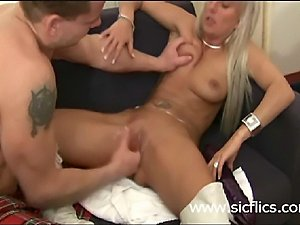 Hot blond MILF brutally fisted in her loose cunt