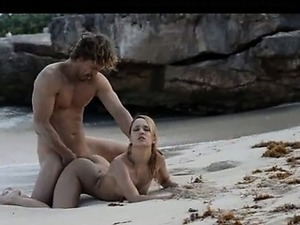 Extreme art sex of sleek couple on beach