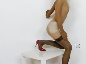 Slender blond-haired full in nylons