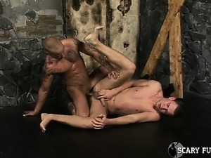 Tattoo Junior whips Stifler's hard cock with leather belt