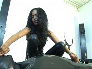 Kinky little black slut adores latex clothing!