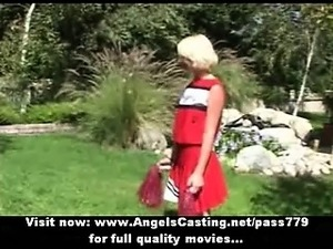 Adorable superb sexy blonde cheerleader training outside