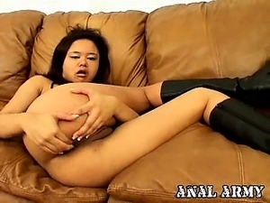 Tempting army slut in boots Annie Cruz masturbating ass on the couch