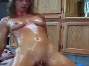 Muscled Babe In Oil Riding Cock