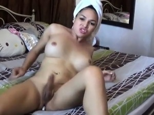 Horny shemale masturbates after the shower