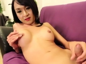 Solo posing ladyboy tugging her cock closeup