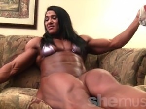Muscled babe On The Couch