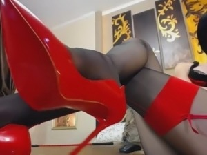 Girl in black pantyhose tease her red high heels