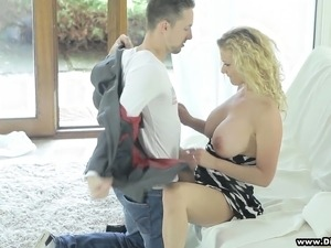 Stacked blonde mom finds it hard to resist a young man with a big dick