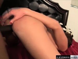 Ravishing redhead stuffs a massive black pole inside her tight peach
