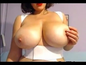 Busty chick rubbing her pussy on cam