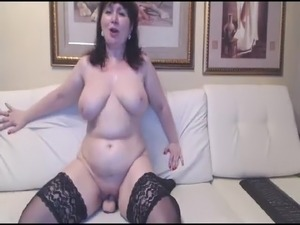 Hot Russian mature mom in stockings ride on toy