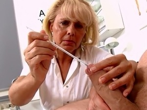 Mature Blonde Nurse measures patients penis soft and erect