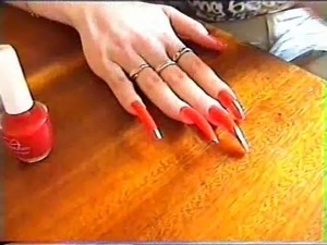 long natural nails red polishing