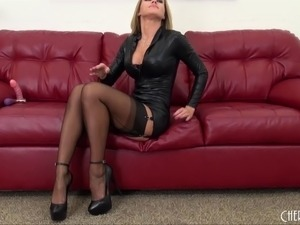 Tantalizing blonde pends on a seat for a steamy screwing of her twat