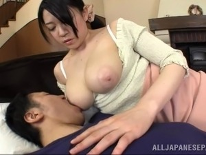 Affectionate Japanese babe getting her big nipples sucked as she gives a...