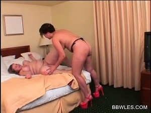 Busty BBW lesbian gets pussy smashed with strapon