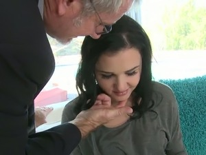 A chick with gorgeous smile is blowing a dick of a mature guy