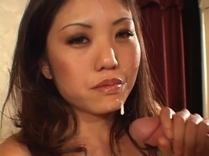 Asian chick giving  a handjob