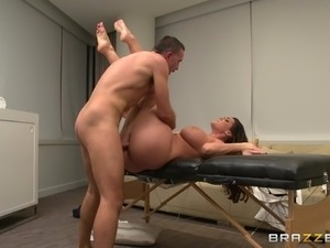 An Oiled-Up Porn Star Enjoying A Hardcore Missionary Style Fuck On A Massage...
