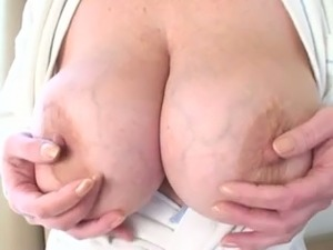 My mature blonde wife plays with her big tits in a hotel room