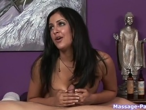 Eye catching brunette masseuse in silk blue gown gives great blowjob