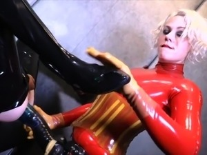Rubber female domination strapon