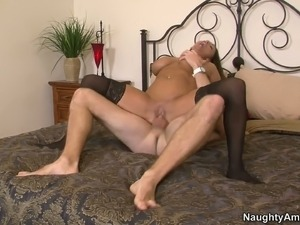 Buxom plump brunette Stacie Starr rides a cock and provides it with a boobfuck