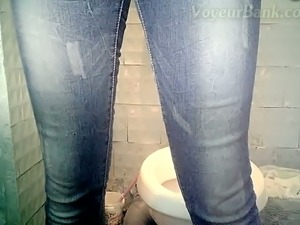 White chick in blue jeans and red panties pissing in the toilet