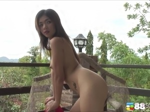 Charming Asian solo model in shorts masturbating in close up