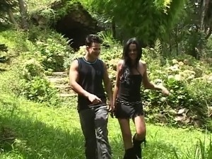 Slim brunette tranny and young dude suck each others' cock in the park