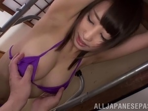 Japanese girl in a bikini gets her cunt massaged nicely