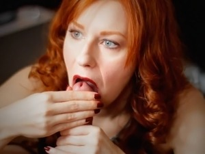 Stunning redhead woman wants to suck on a throbbing cock