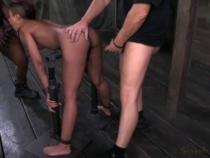 Tattooed slave pleasured with vibrator in BDSM porn