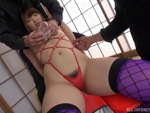 Toy fetish Asian dame giving cocks blowjob in BDSM
