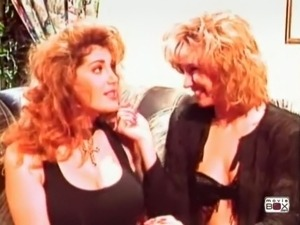 Two voracious classic white ladies on the sofa kissing